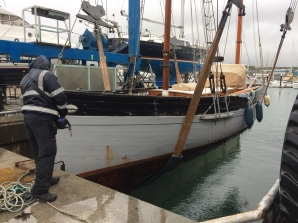 Guiding Star in the hoist at Plymouth Yacht Haven in pouring rain