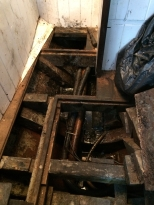 Mid bilge under the galley sole with ballast ingots removed