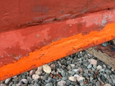 Red lead on top of red lead putty along the join between the sacrificial strip and the keel